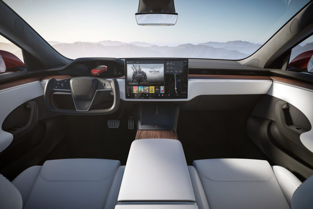 A rendering of the interior of the new Tesla Model S Plaid, complete with yoke wheel