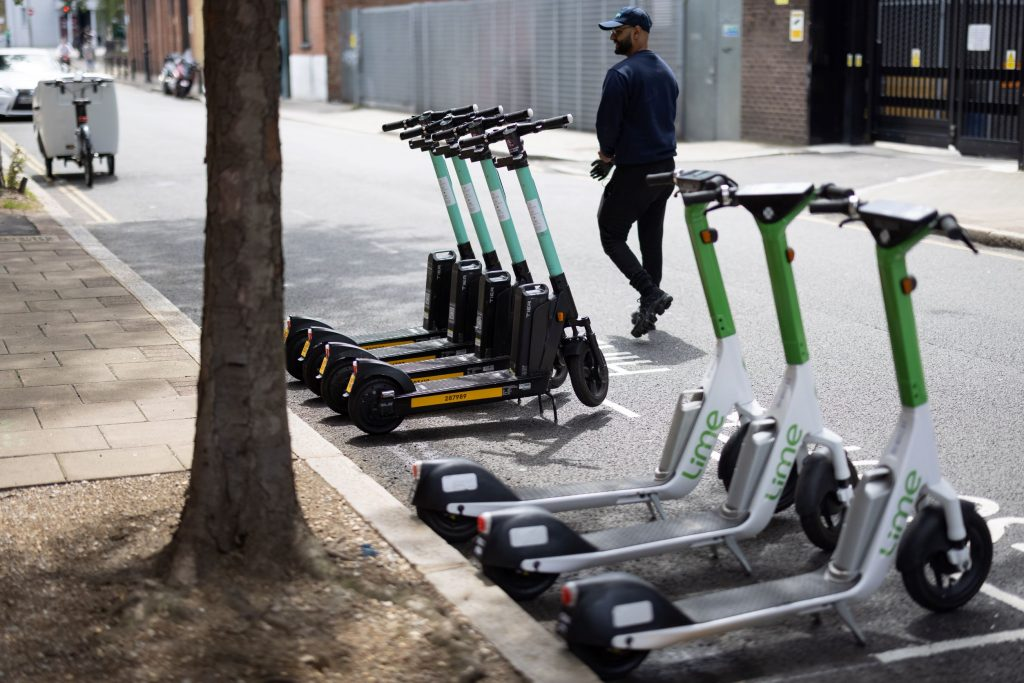 A line of Lime and Tier electric motorized scooters in London, England