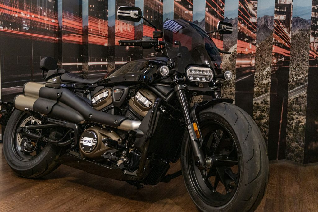 The front 3/4 view of an accessorized black 2021 Harley-Davidson Sportster S