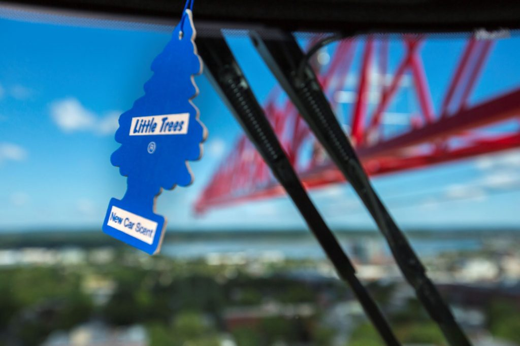 A blue Little Trees air freshener hanging within a crane in Portland