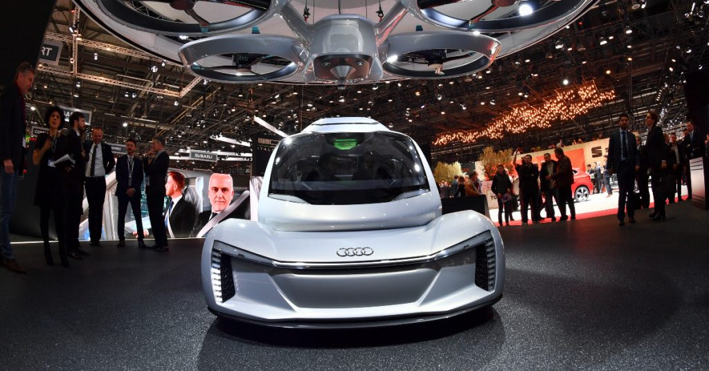 A silver Audi concept flying car.