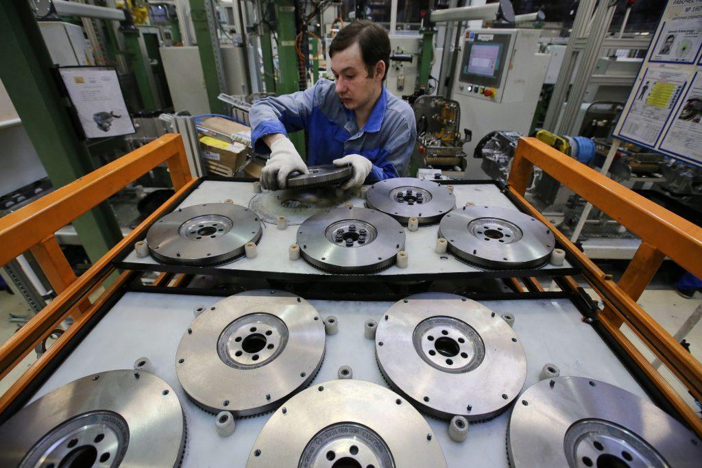 A Russian worker arranges AvtoVAZ clutch flywheels at the company's factory in Togliatti, Russia