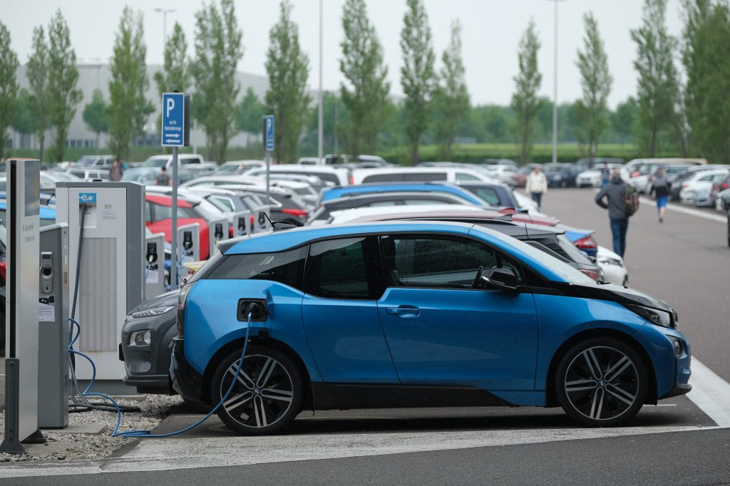 A blue BMW i3 electric car charges its battery outside the BMW factory on May 20, 2019, in Leipzig, Germany