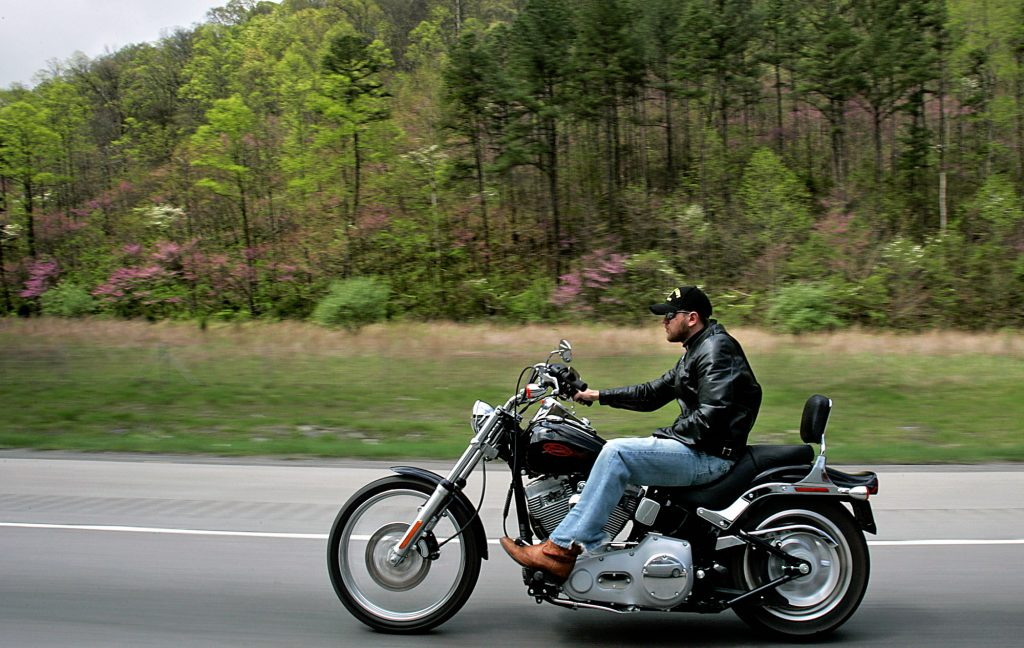 Blake Miller rides the backroads of Kentucky on his new Harley-Davidson motorcycle