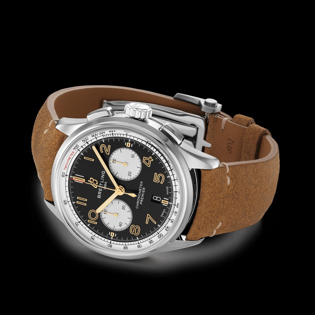 The silver-cased black-and-gold-dialed Breitling Premier B01 Chronograph 42 Norton with a brown-leather strap