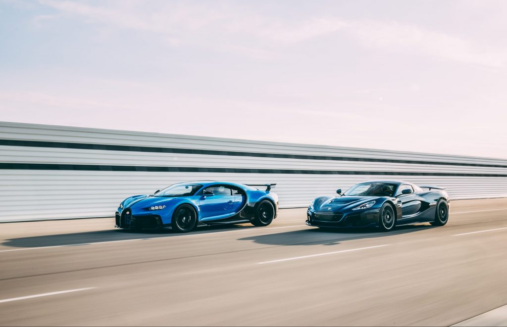 A blue-and-black Bugatti Chiron Sport and a black Rimac Nevera speed around a racetrack