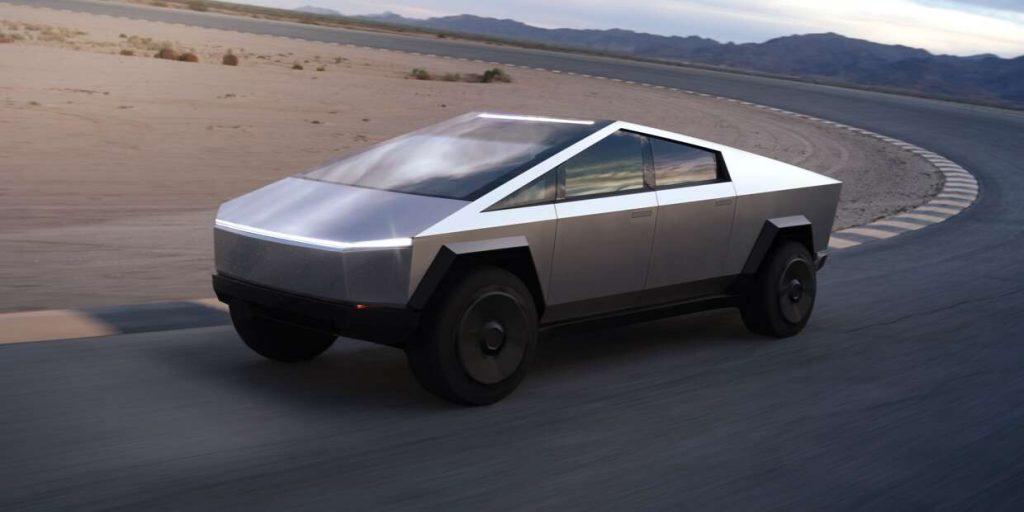The Tesla Cybertruck drives around a curve in a desert.