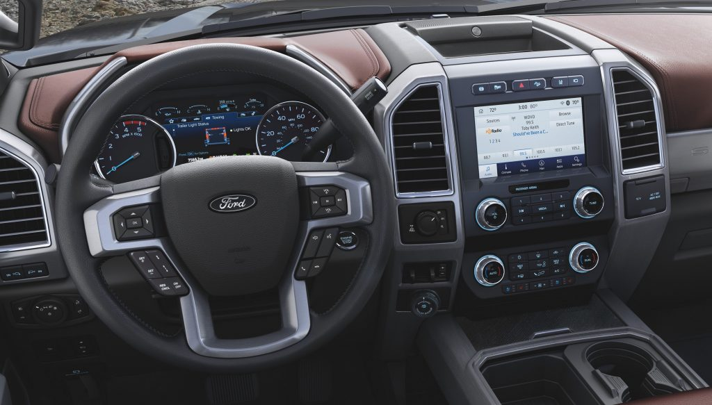 The tan leather interior of a Ford F-350 truck