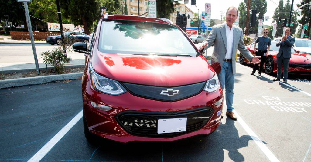 Congressman Adam Schiff plugs in his Chevy Bolt during the unveiling of new electric vehicle charging ports in Downtown Burbank on Monday, July 12, 2021.