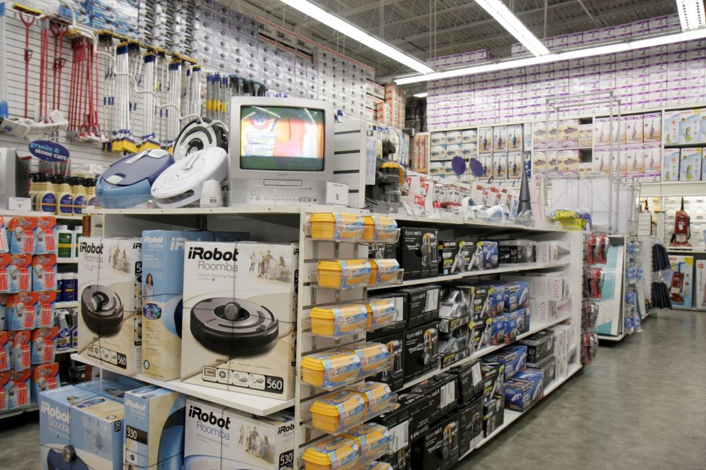Robot vacuum cleaners on a merchandise display in a Bed Bath & Beyond