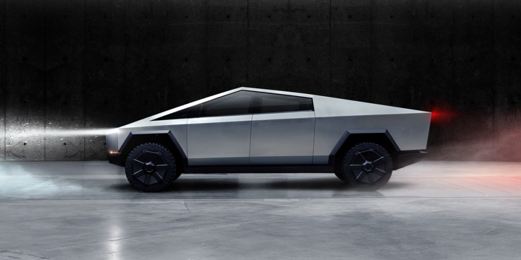 The futuristic, silver and angular Tesla Cybertruck.