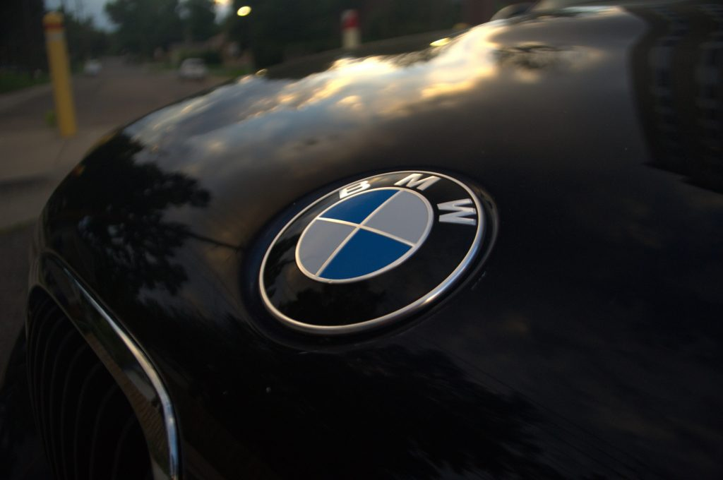 Black and blue Carbon Schwartz Metallic paint on a BMW M3, with the badge pictured on the hood