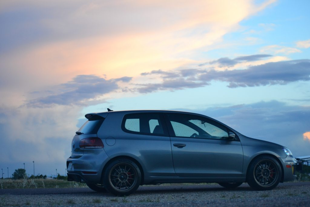 A gray Volkswagen GTI at sunset photographed in profile.