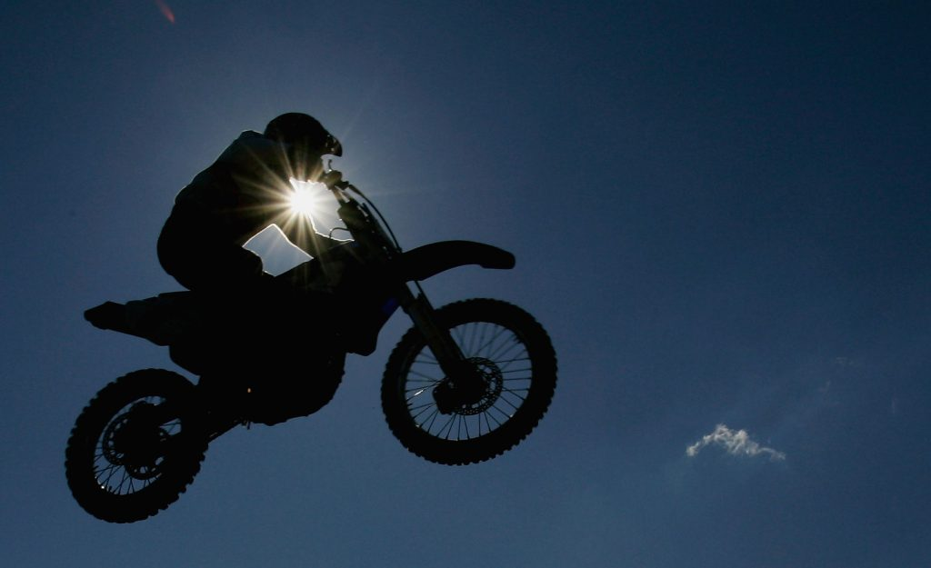 A silhoutte of a motorbike is seen during the Moto Cross side car World Cup Final. Triumph is getting into motocross and enduro
