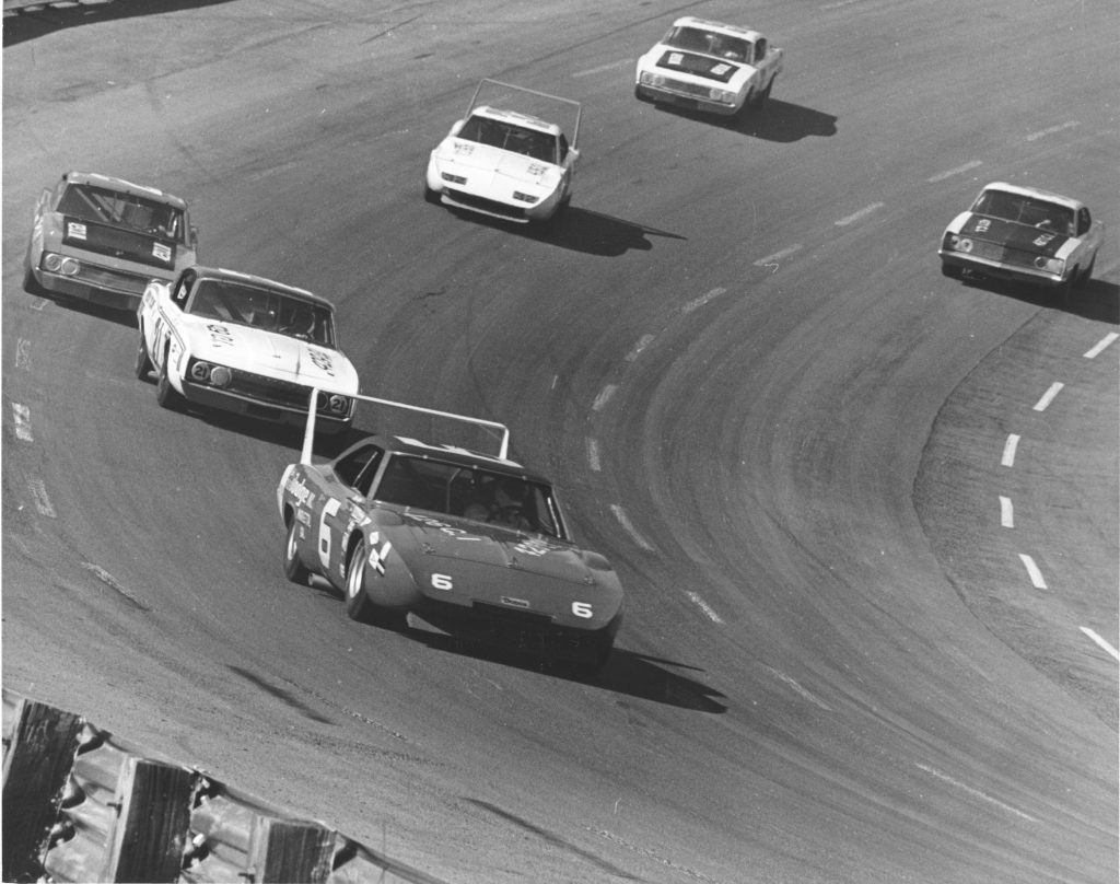 A Dodge Daytona leads the field during a NASCAR Grand National race in 1970