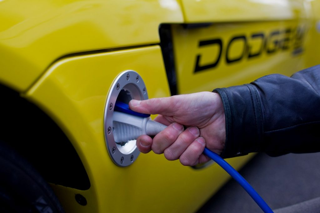 A charging cord plugged into a Dodge EV concept model