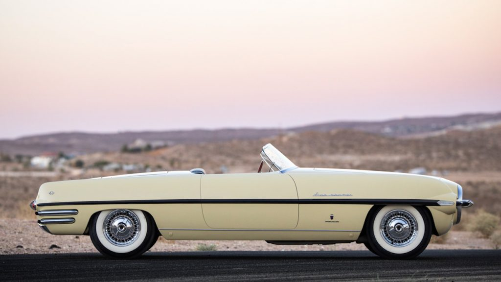 1954 Dodge Firearrow II parked at sunset