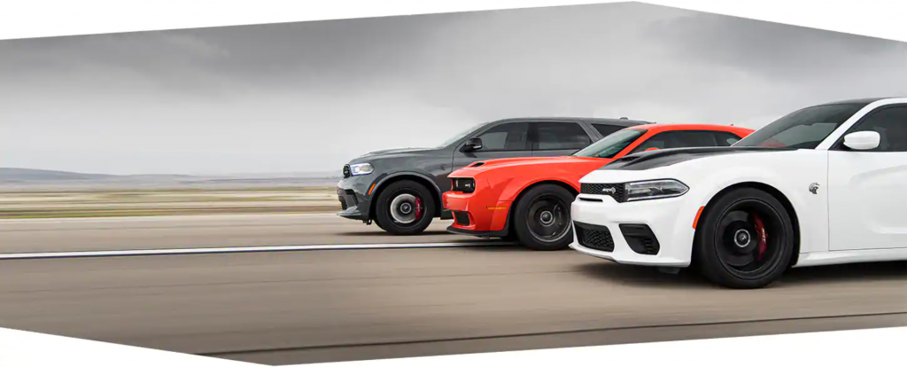 A gray Dodge Durango, an orange Dodge Challenger, and a white Dodge Charger