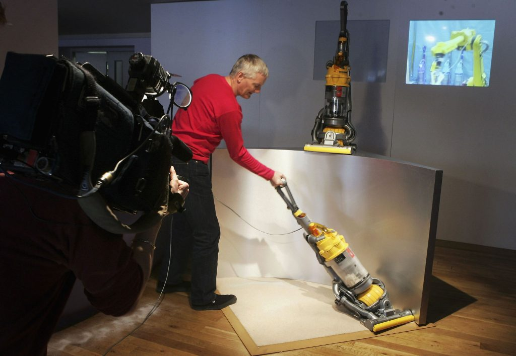 Inventor James Dyson demonstrates his latest vacuum cleaner on March 14, 2005, in London
