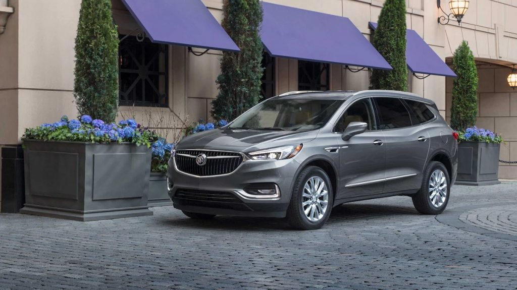 A 2021 Buick Enclave parked in front of a store.
