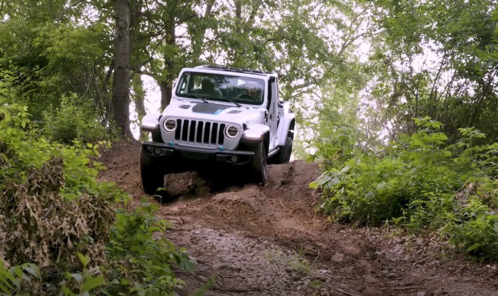 All-electric Jeep Freedom ripping through an off-road trail