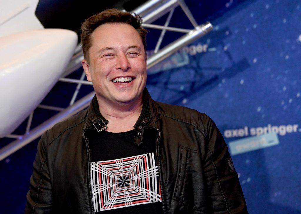 Elon Musk in front of a blue and white background. Morgan Stanley thinks Tesla electric aircraft will be a thing one day.