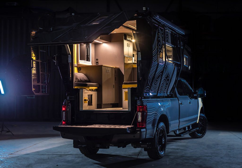 Truck camper opened up at night