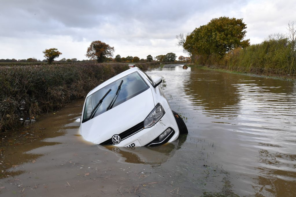 A flooded car in a river in England