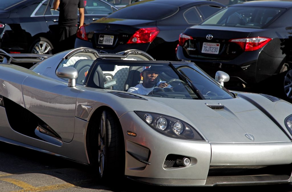 Floyd Mayweather Jr. arrives at the Mayweather Boxing Club in his new $4.8 million Koenigsegg CCXR Trevita hypercar for a workout in August 2015 in Las Vegas