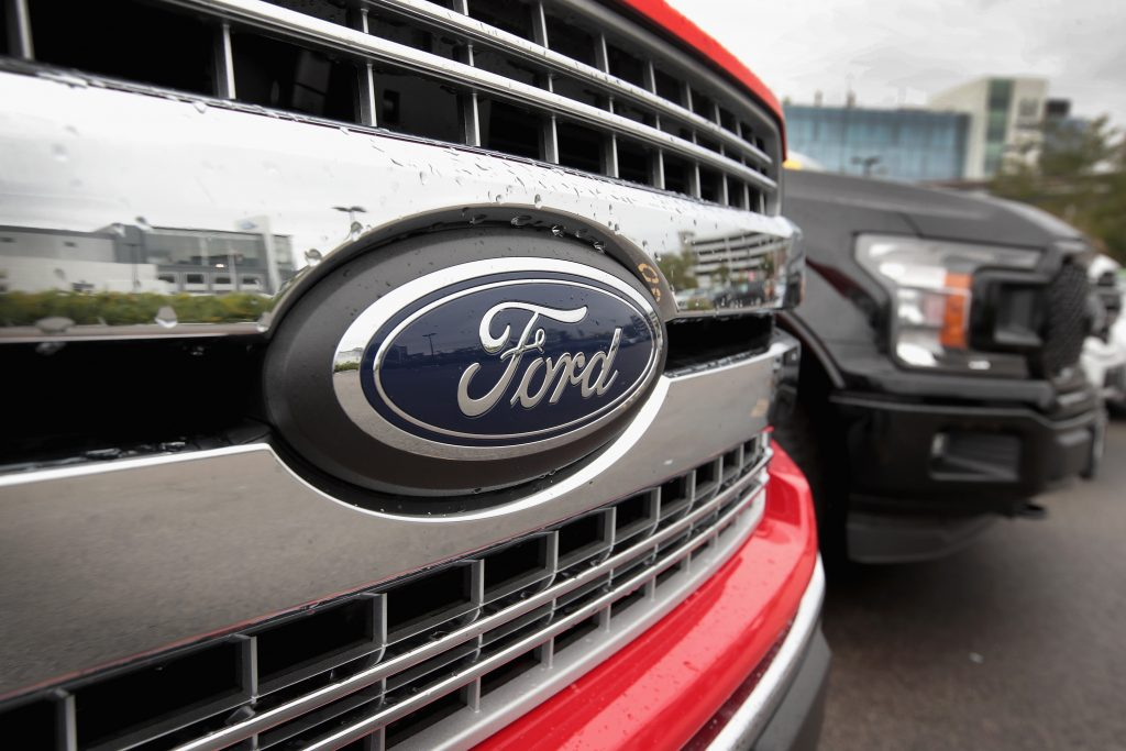 The front grille of a red Ford F-150 pickup truck