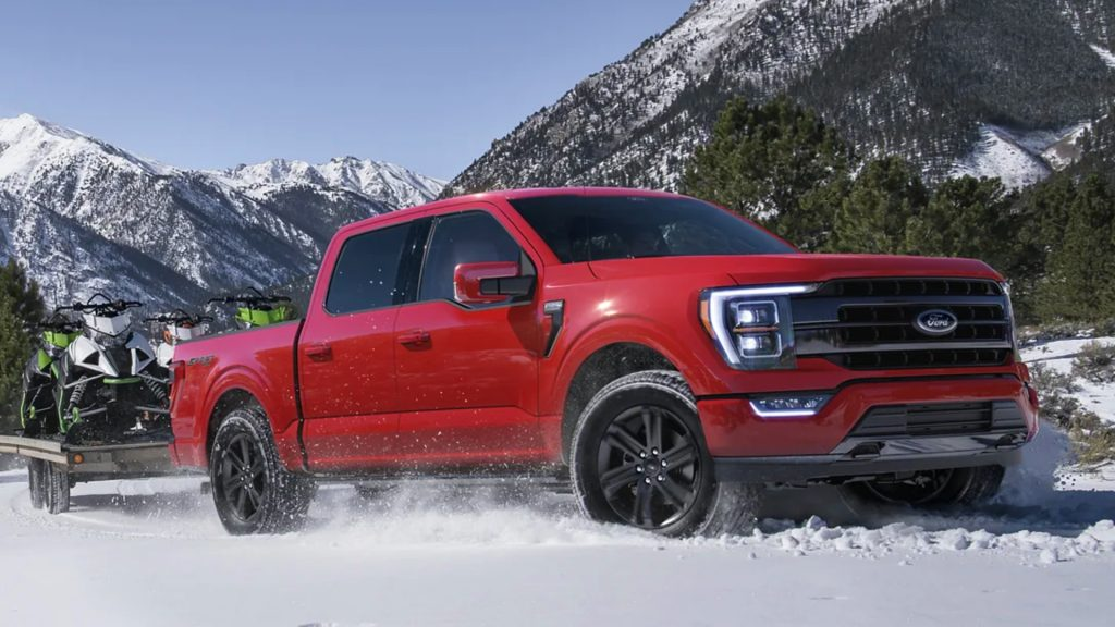 A red Ford F-150 in the snow.