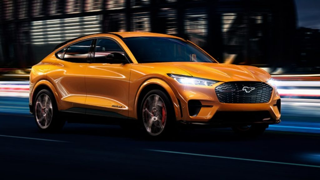 An orange Ford Mustang Mach-E.