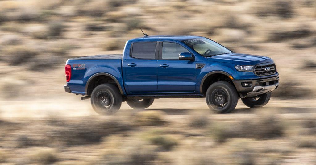 A Blue Ford Ranger Driving Down Desert Roat