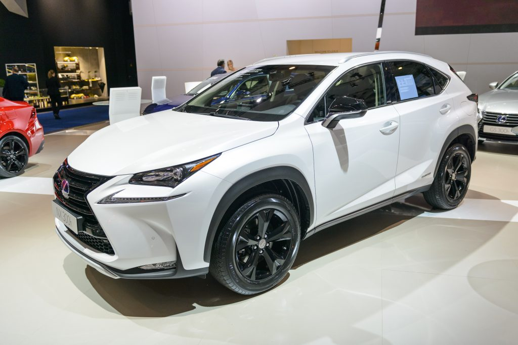a white 2016 Lexus NX hybrid on display at an indoor auto show is an example of one of the best used lexus SUVs according to Consumer Reports