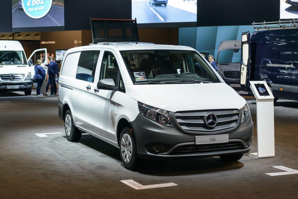 A white Mercedes-Benz Metris cargo van on display at an auto show.