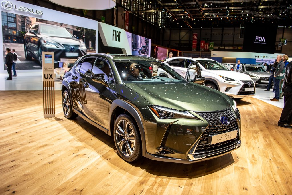 a green 2019 Lexus UX on display at an indoor auto show