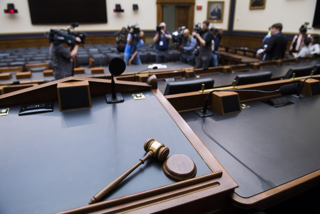 A gavel on a judge's stand in a courtroom