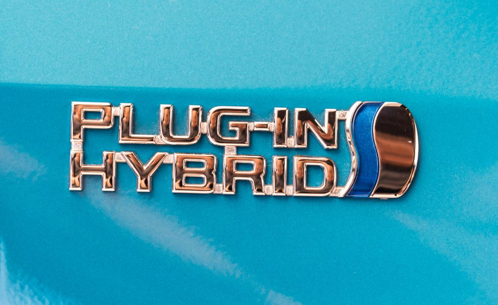 A silver Plug-In Hybrid Electric Vehicle (PHEV) badge