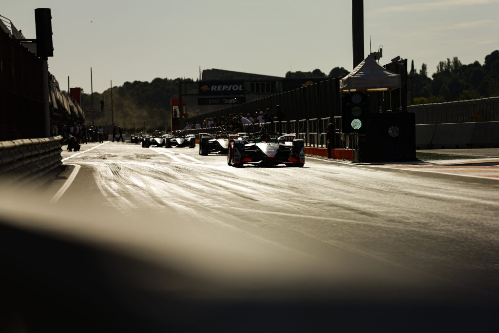 Silhouette of Formula E race cars in the pit lane