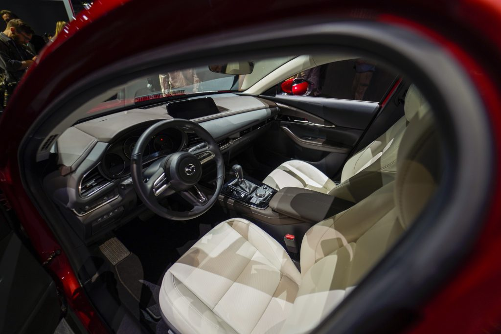 the interior of the 2021 Mazda CX-30 view from outside the driver's side looking into through the open door