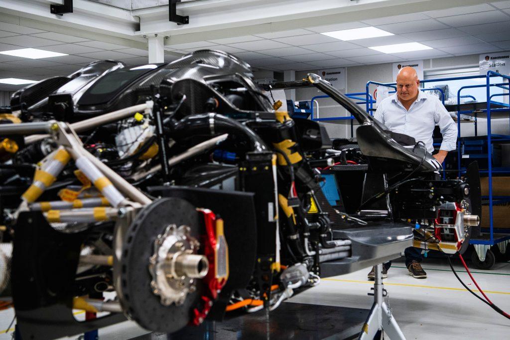 Founder Christian von Koenigsegg gazes at his Regera hypercar, still being assembled