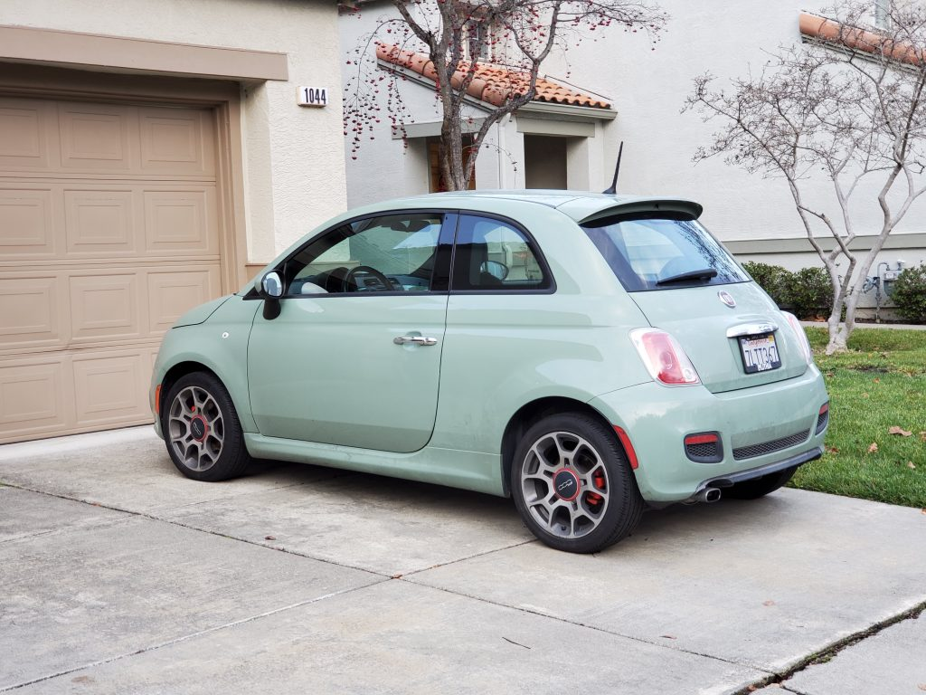 a mint green 2019 Fiat 500 parked in a driveway