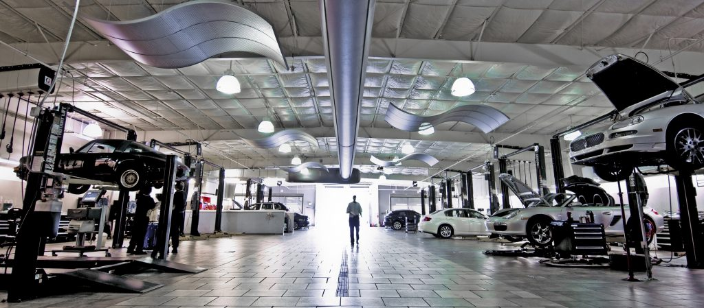 Car recalls are often performed in a dealership shop like this one, with pristine white floors