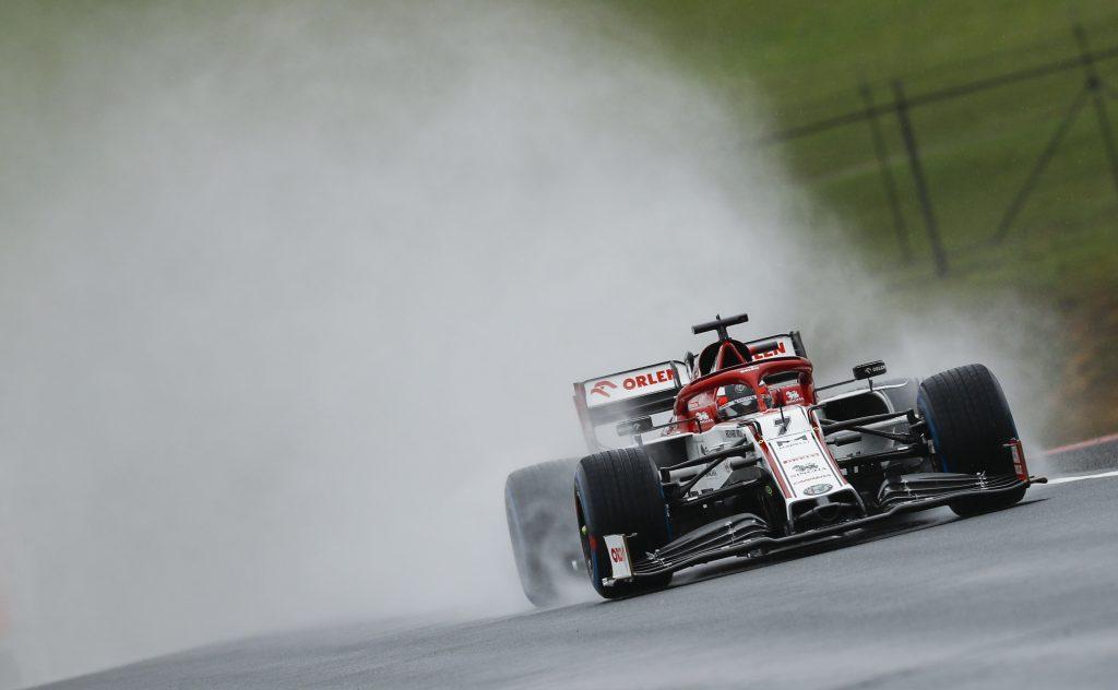 Kimi Raikkonen's F1 car throws rainwater high into the air on a straight
