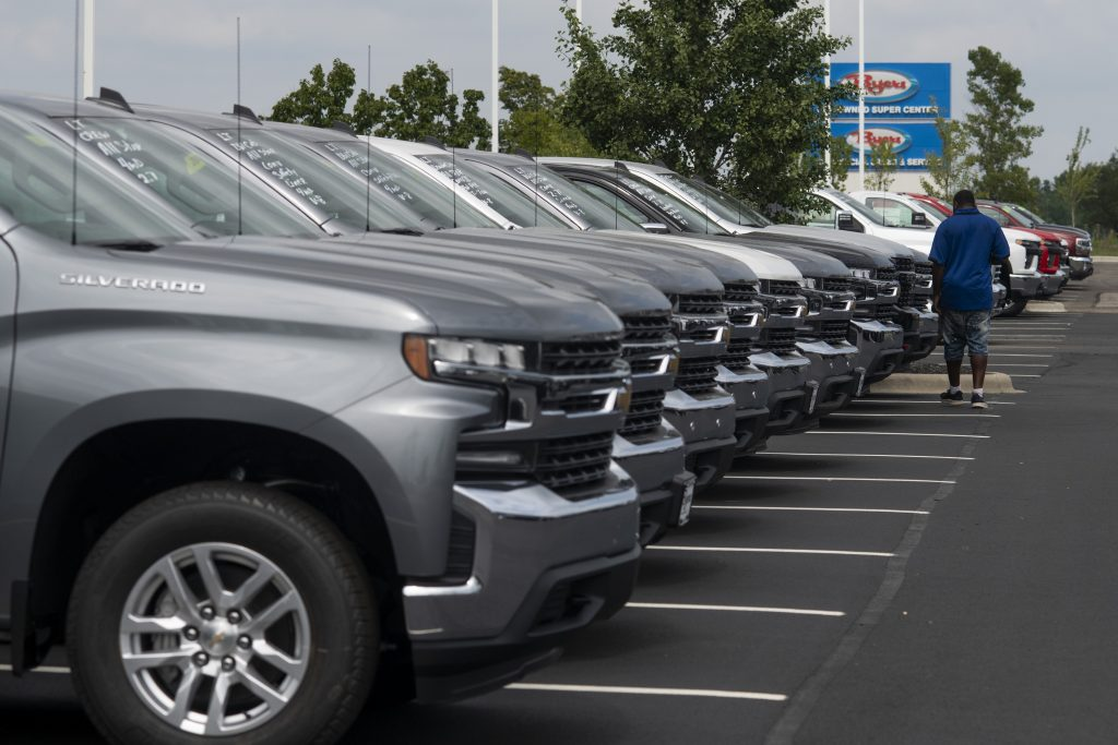 A customer looks over Chevrolet vehicles | Getty Images