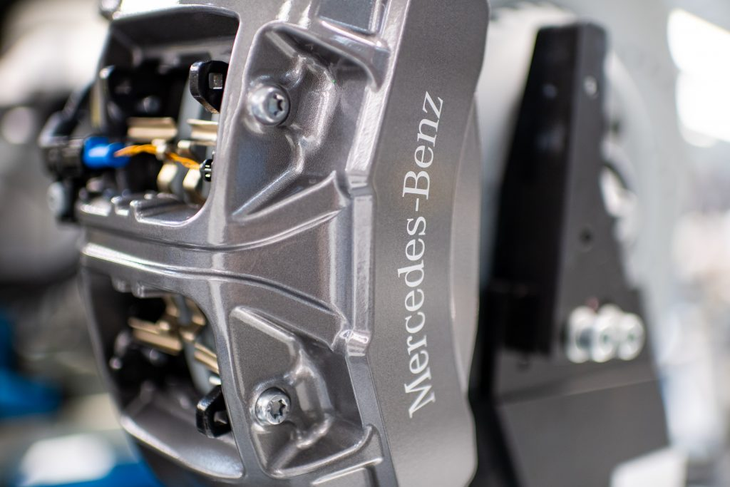 The brake caliper of a new Mercedes-Benz in the factory
