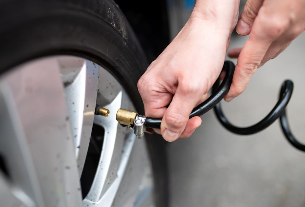 A woman fills her tires with air
