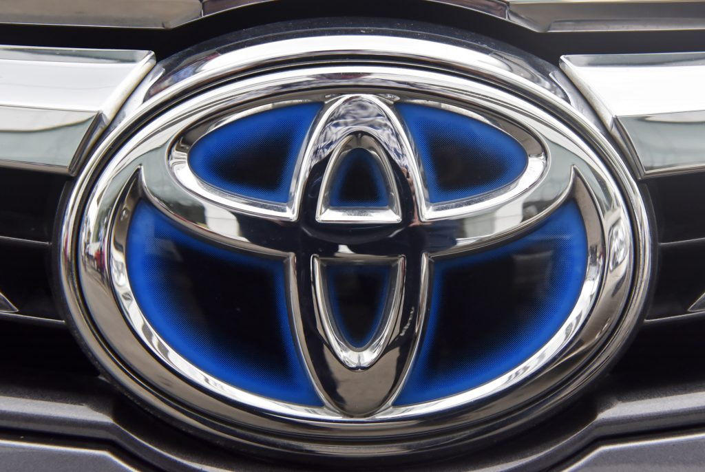 The Toyota logo seen on one of the brand's hybrid models