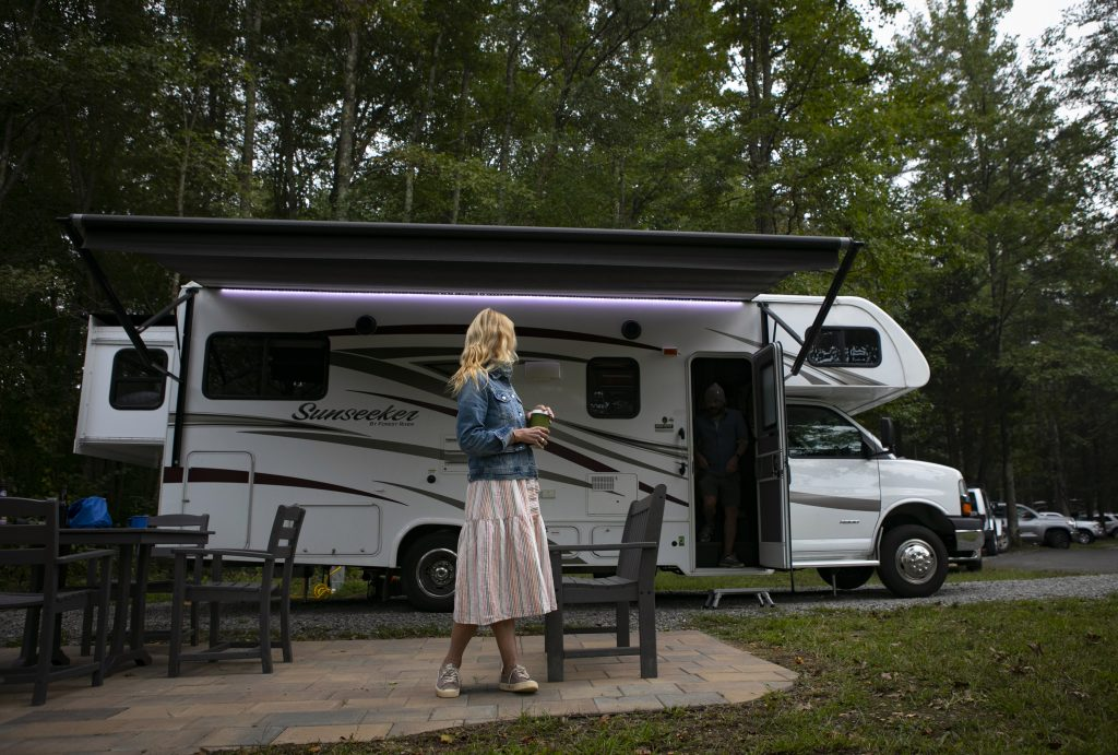 A travel writer enjoying her rented RV at a scenic camp ground