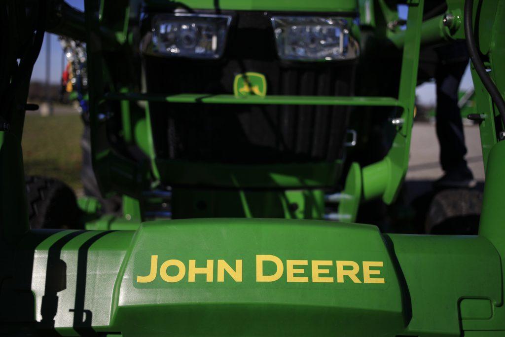 Signage on a Deere & Co. farm implement at a John Deere dealership